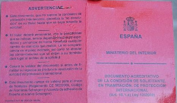 What is the red card in the asylum procedure in Spain