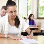 Student woman writing